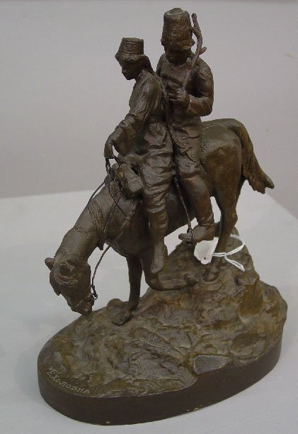 9: BRONZE STATUE. Cossack and a woman riding