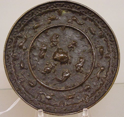 23: BRONZE CHINESE MIRROR. Round with cast an