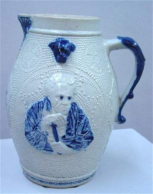 LARGE BLUE AND WHITE STONEWARE PITCHER. A