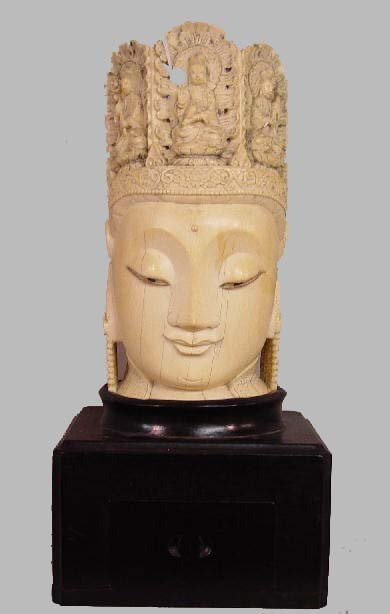176: LARGE CARVED IVORY HEAD. Oriental with f