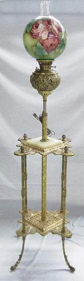 PIANO LAMP. Cast iron base has brass fini
