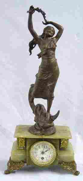 FIGURAL CLOCK. Spelter woman standing on
