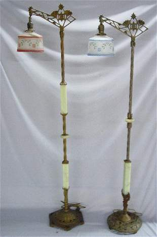 TWO CAST IRON FLOOR LAMPS. Both have gree