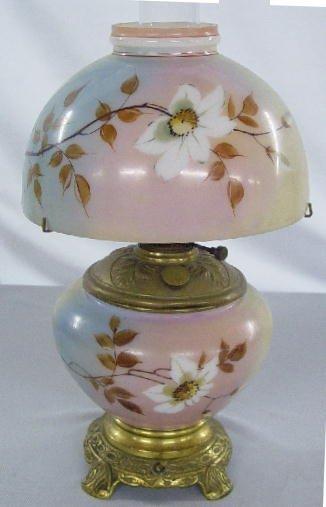 1008: SMALL KEROSENE TABLE LAMP. Shaded rainb