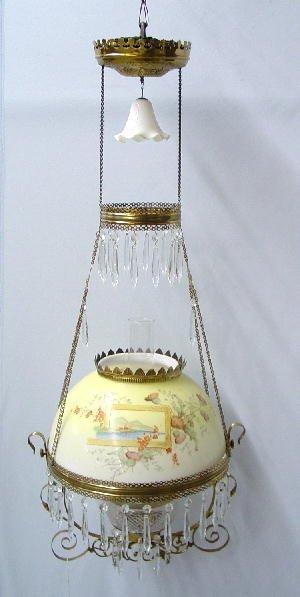 1009: HANGING LAMP. Opaque shade has yellow b
