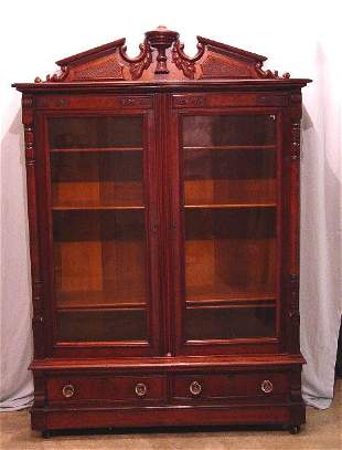 VICTORIAN BOOKCASE. Mahogany with an ur