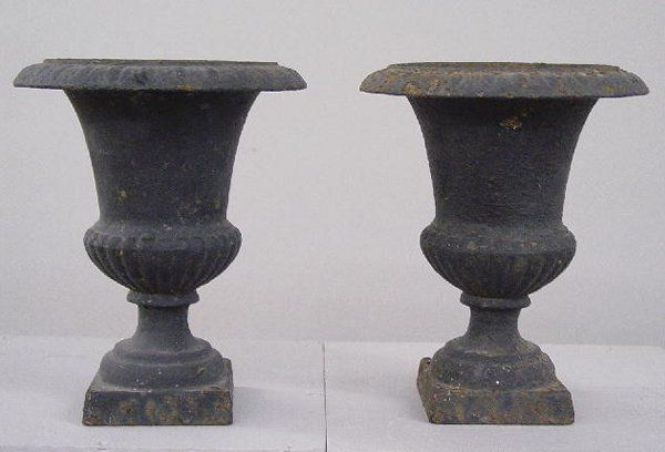 PAIR OF SMALL CAST IRON GARDEN URNS. Old
