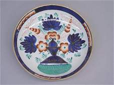 38: PAIR OF GAUDY IRONSTONE CHARGERS. Unusual