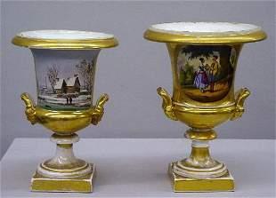 TWO OLD PARIS URNS. Porcelain with gildi