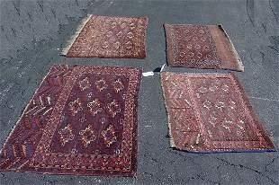 FOUR ORIENTAL RUGS. Turkomans. Three sad