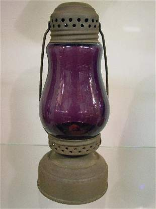 SKATER' S LAMP. Tin with an amethyst glo