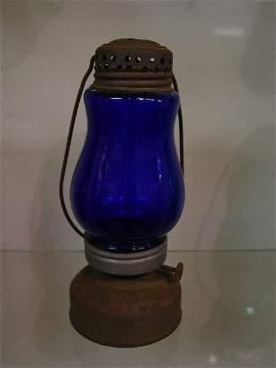 SKATER'S LAMP. Tin with a cobalt globe.