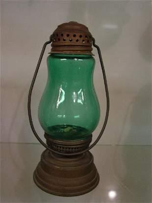 SKATER'S LAMP. Brass with a grass green