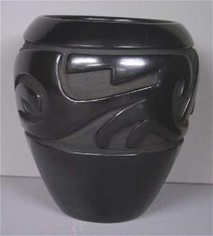 SANTA CLARA PUEBLO POTTERY JAR. Carved b