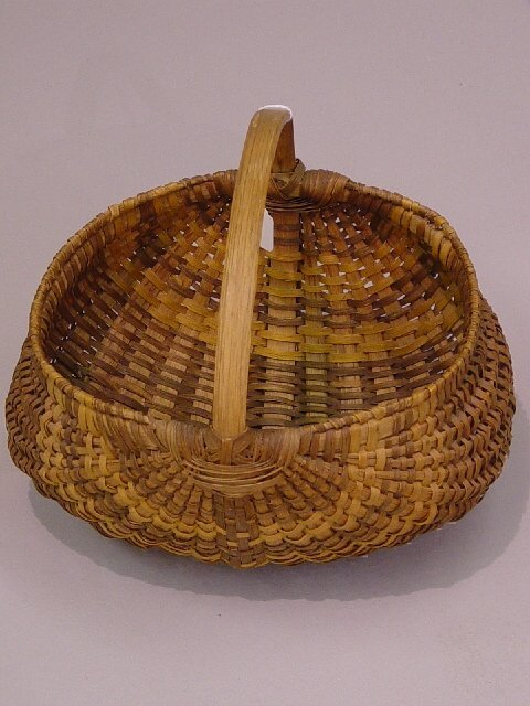 9: FINELY WOVEN SPLINT MELON BASKET. Brown an