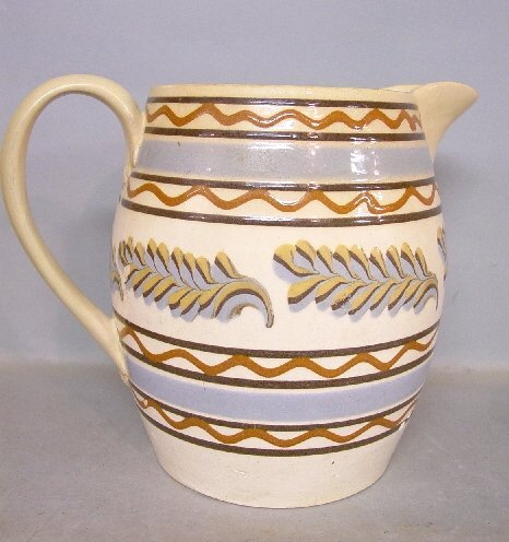 21: MOCHA PITCHER. Pale blue bands and burnt