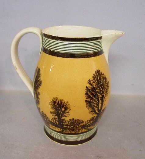 22: MOCHA PITCHER. Tooled green bands, dark b