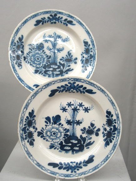 5: PAIR OF DELFT PLATES. Tin glaze with floral designs