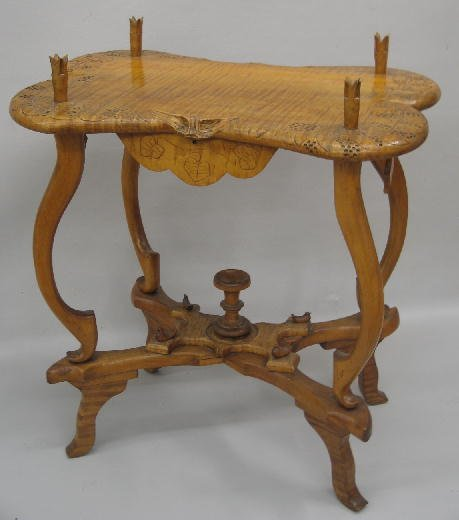 22: FOLK ART TABLE. Carved maple with curly maple top,