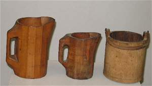 169 THREE PIECES OF WOODEN WARE Two panelled noggins