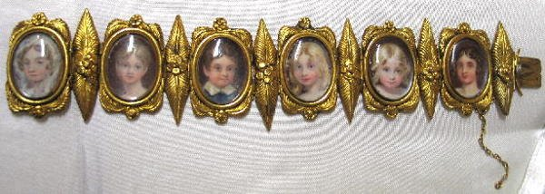 7: FINE BRACELET WITH MINIATURES ON IVORY. Six painted