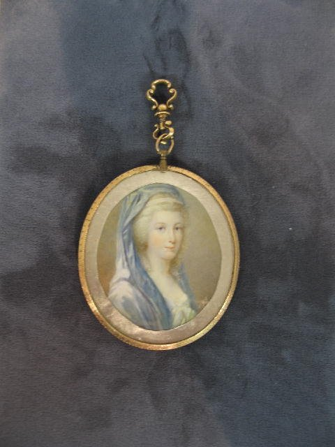 13: MINIATURE ON IVORY. Double sided locket with a port