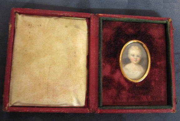 14: MINIATURE ON IVORY. Portrait of a young child with