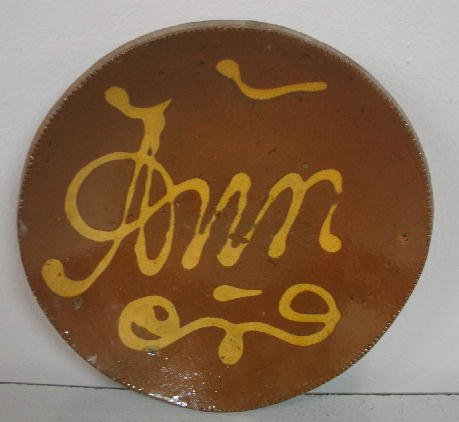 20: SMALL REDWARE PIE PLATE. Coggled rim with the name