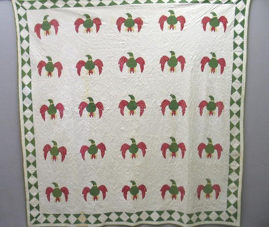 363: APPLIQUE QUILT. Cotton. Twenty-five red and green