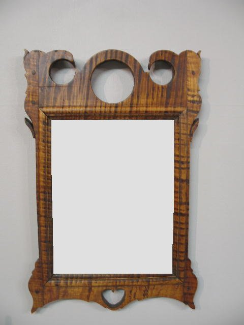 364: FOLK ART FRAMED MIRROR. Wonderful curly maple fram