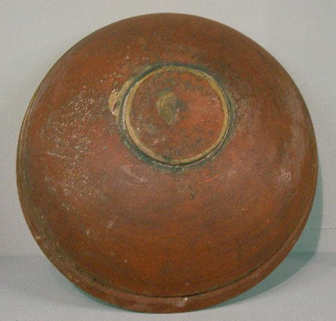 4: TURNED BOWL IN OLD RED PAINT. Shallow turned foot wi