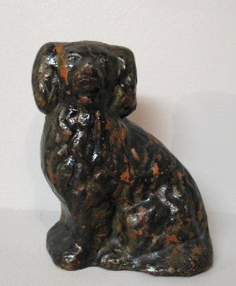 9: REDWARE DOG. Seated dog molded from dark red clay wi