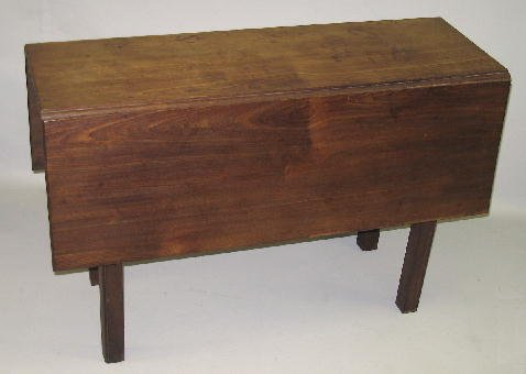 24: CHIPPENDALE DROP LEAF TABLE. Walnut with pine secon