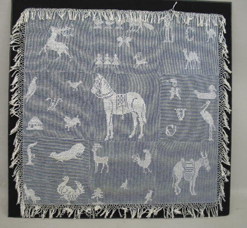 451: TABLE COVER.  White cotton cross-stitch on blue an