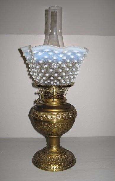 """7: BRASS OIL LAMP. """"The New Juno No. 2"""". Embossed brass"""