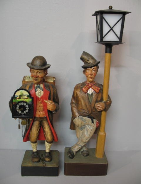 16: TWO WOODEN WHISTLING FIGURES. A hobo at a light pol