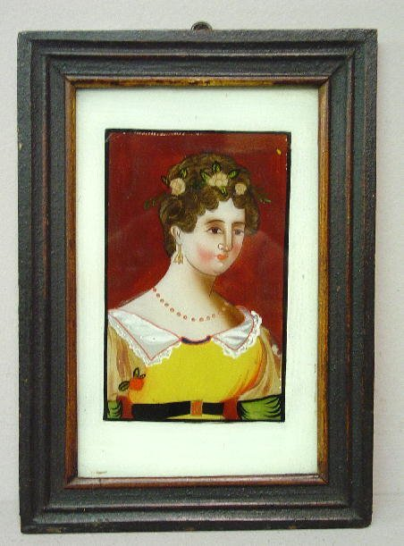 2: REVERSE PAINTING ON GLASS. Woman wearing a yellow dr