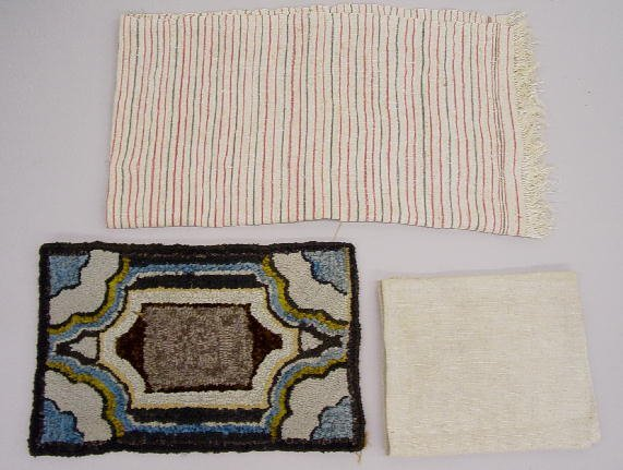 11: THREE TEXTILES. Pictured is a small hooked mat with