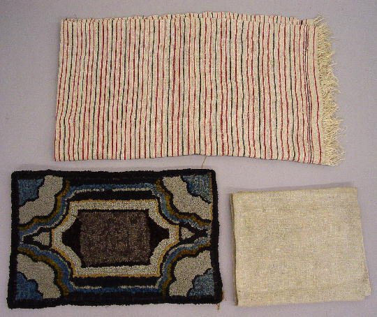 11: THREE TEXTILES. Pictured is a small hooked mat with - 2