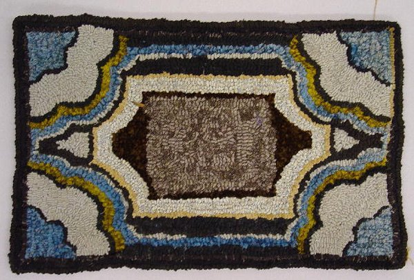 11: THREE TEXTILES. Pictured is a small hooked mat with - 3