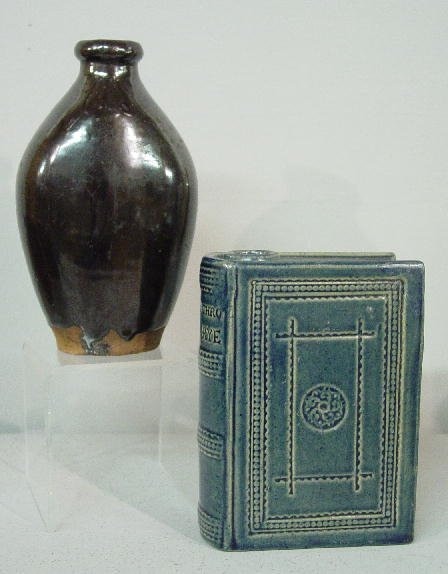 18: TWO FLASKS. Pictured is a blue glazed book flask. I