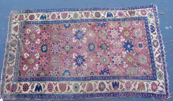 439A: ORIENTAL RUG. Kurdish. Floral designs with ivory