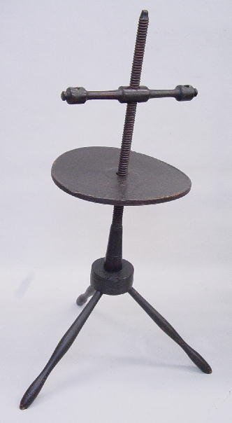 601: WINDSOR CANDLESTAND. Old black paint over an earli