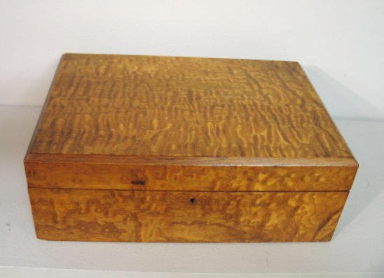 103: TABLE TOP WRITING DESK. Flame birch veneer over ce