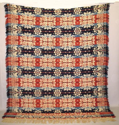 402: JACQUARD COVERLET. Two-piece in red, blues and nat
