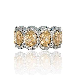 18KT TWO TONE GOLD YELLOW DIAMONDS HALO OVAL BAND. THIS