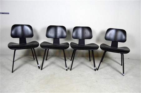 Set of Four Eames Molded Plywood Dining Chairs (DCW)