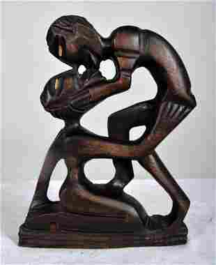 African Statue of Man and Woman Intertwined