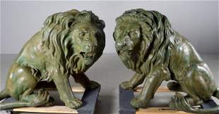 Pair of Seated Bronze Lions