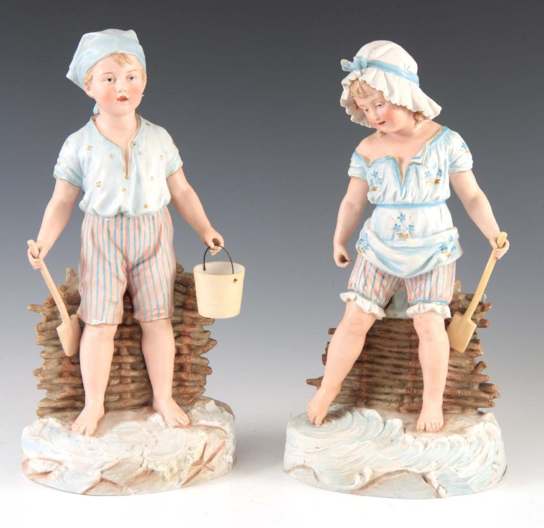 A 19TH CENTURY LARGE PAIR OF BISQUE PORCELAIN FIGU